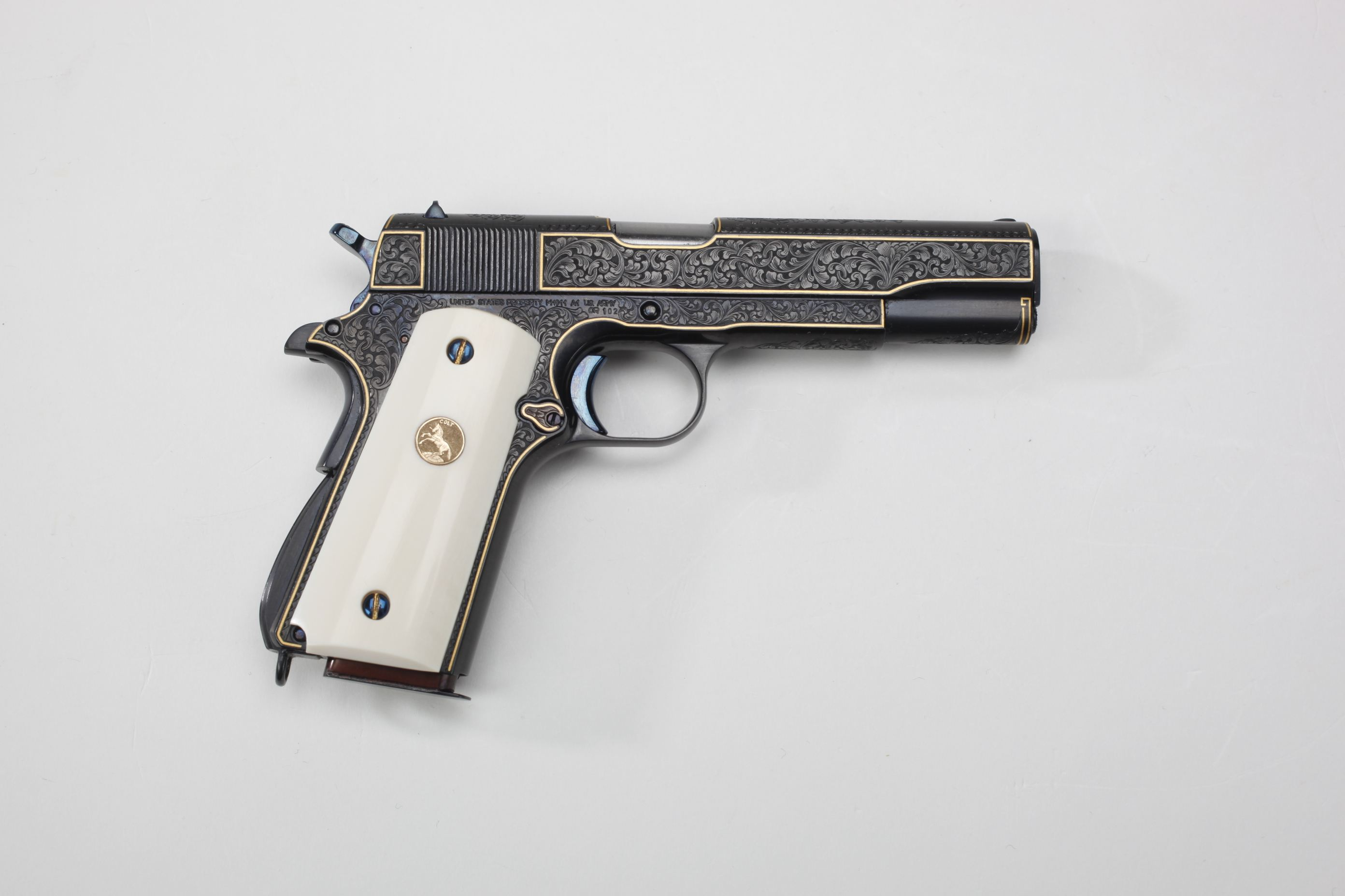Miniature engraved Colt Government Model Pistol with ivory grips